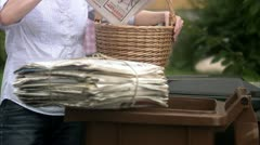 Man and woman recycling newspapers Stock Footage
