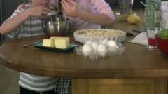 Brother and sister baking Stock Footage