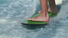Surfing a Standing Wave: Flowrider Close Up Feet Stock Footage