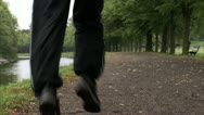 Man jogging by a canal Stock Footage
