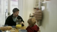 Family with a small child having breakfast - stock footage