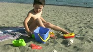 Little boy playing in the beach Stock Footage
