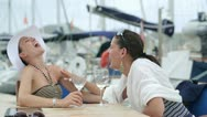 Stock Video Footage of Two laughing women drinking wine near marina, steadycam shot