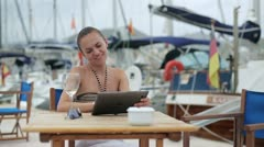 Two young women meet at marina, steadycam shot Stock Footage