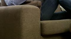 MS TU Man sitting on sofa reading newspaper Stock Footage