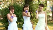 3 brides are talking on the phones Stock Footage