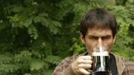 Man drinking a dark beer Stock Footage