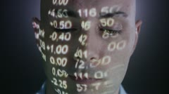 A man with the stock-exchange quotation reflected on his face Stock Footage