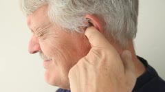 Man with pain in ear Stock Footage