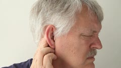 Man with earache Stock Footage