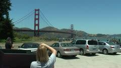 Woman taking photo of Golden Gate Bridge Stock Footage