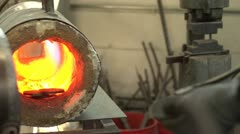 Pieces of steel put in an oven before being forged Stock Footage