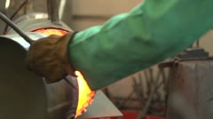 Man removing steel from a furnace, then hammer forging Stock Footage