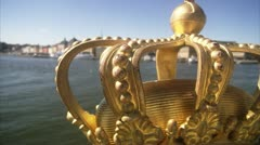 CU TU Golden crown at edge of bridge / Stockholm Stock Footage