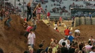 Obstacle course people down final hill slow P HD 0843 Stock Footage