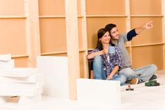 Home improvement young couple relax building wall Stock Photos