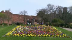 Tourists in gardens outside Shrewsbury Castle, Shropshire Stock Footage