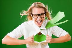 green superhero businesswoman crazy face - stock photo
