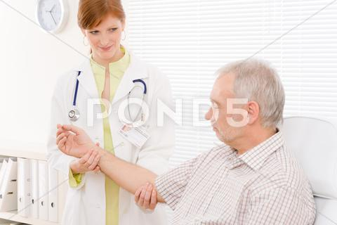 Stock photo of doctor office - female physician examine patient