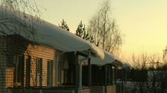 Snow on the roofs at sunset 1 - stock footage