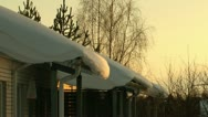 Stock Video Footage of Snow on the roofs at sunset 2