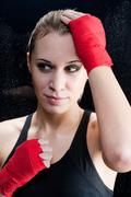 portrait - boxing training blond woman sparring - stock photo