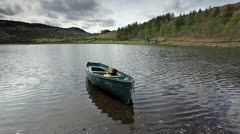 A small boat on Watendlath Tarn in the Lake District - stock footage