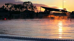 Olympic Pool at Sunset with Mist Stock Footage