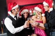 Christmas party friends at bar toast champagne Stock Photos