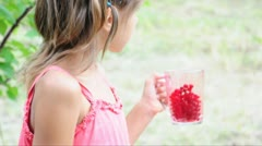 Child eating red current Stock Footage