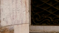 Masked woman looking around the corner - Venice, Venezia Stock Footage