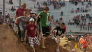 Obstacle course people at final hill very slow P HD 0841 Stock Footage