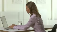 A woman using a computer in an office, Stockholm Stock Footage