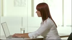 A woman sitting in an office using her laptop, Stockholm Stock Footage