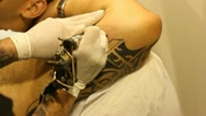 Tattoo shop tattooing pain artists body art skin needle draw sterile hiv pain Stock Footage