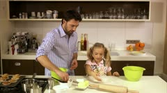 Father and daughter baking together, Stockholm Stock Footage