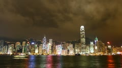Hong Kong city sky line at night from Victoria harbour view Stock Footage