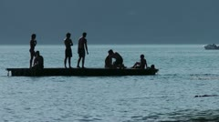 Teenager playing on floating bar Stock Footage