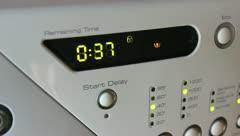 Dolly shot of washing machine controls Stock Footage