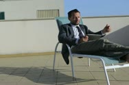Businessman with documents talking on cellphone, outdoor Stock Footage