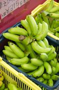 Bananas being sold in Okinawan market. Stock Photos