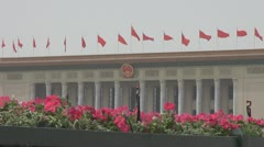 The Great Hall of the People China's flags Beijing China day flower building Stock Footage