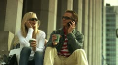 A couple sitting outdoors having a cup of coffee, Stockholm Stock Footage