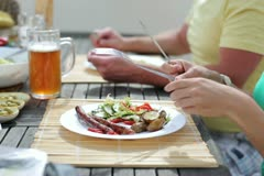 Couple eating dinner on the terrace Stock Footage