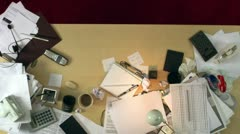 A messy desk is cleaned up - stock footage
