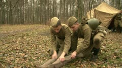 Stock Video Footage of The soldiers at the camp rolled down coat