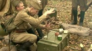 Stock Video Footage of Soldiers with a knife opens canned food