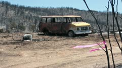Vehicle and house destroyed by wildfire P HD 0911 Stock Footage
