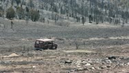 Vehicle van destroyed by mountain wildfire P HD 0923 Stock Footage