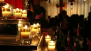 Buddha Bar | candles illuminate an Asian themed bar Stock Footage
